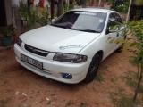 Mazda Familia BHALP Car For Rent.